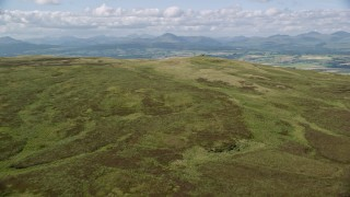 AX110_025 - 6K stock footage aerial video approach Carleatheran in Gargunnock Hills, Scotland
