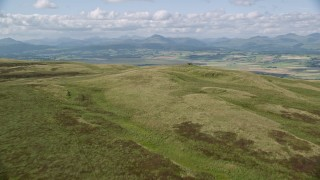 AX110_026 - 6K stock footage aerial video approach Carleatheran from the Gargunnock Hills, Scotland