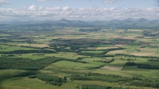 AX110_028 - 6K stock footage aerial video approach farms and fields around Kippen, Scotland