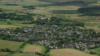 AX110_031 - 6K stock footage aerial video flyby a Scottish village, Kippen, Scotland