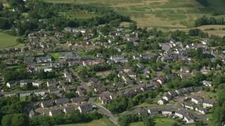 AX110_032 - 6K stock footage aerial video of an orbit of the Scottish village of Kippen, Scotland