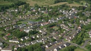 AX110_033 - 6K stock footage aerial video of orbiting a Scottish village, Kippen, Scotland