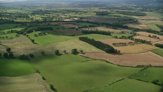 AX110_035 - 6K stock footage aerial video fly over Scottish farms and fields near Kippen, Scotland