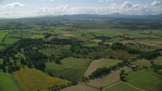 AX110_036 - 6K aerial stock footage video of flying over farm fields in a rural Scottish landscape, Buchlyvie, Scotland