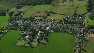 AX110_042 - 6K stock footage aerial video fly over small Scottish village, Gartmore, Scotland