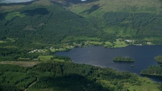 AX110_043 - 6K stock footage aerial video of Loch Ard surrounded by forest by village of Blairhullichan, Scotland