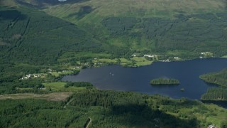 AX110_044 - 6K stock footage aerial video of Loch Ard surrounded by forest by village of Blairhullichan, Scotland