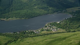 AX110_066 - 6K stock footage aerial video of Arrochar village on the shores of Loch Long, Scottish Highlands, Scotland
