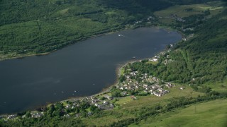 AX110_067 - 6K stock footage aerial video of a village on the shore of Loch Long, Arrochar, Scottish Highlands, Scotland