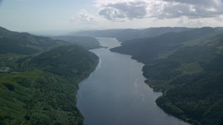 AX110_069 - 6K stock footage aerial video of Loch Long flowing past lush green mountains, Scottish Highlands, Scotland