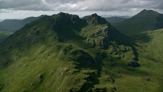 AX110_072 - 6K stock footage aerial video approach The Cobbler, a green mountain peak, Scottish Highlands, Scotland