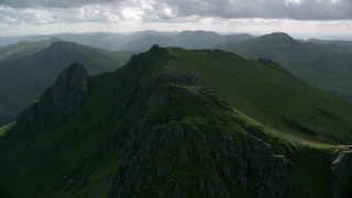 AX110_076 - 6K stock footage aerial video of orbiting green mountain peak, The Cobbler, Scottish Highlands, Scotland