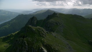 AX110_077 - 6K stock footage aerial video of The Cobbler a green peak, Scottish Highlands, Scotland