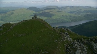 AX110_079 - 6K stock footage aerial video of orbiting The Cobbler with views of Loch Long, Scottish Highlands, Scotland
