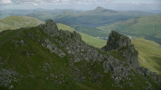 AX110_080 - 6K stock footage aerial video of orbiting The Cobbler Mountain, Scottish Highlands, Scotland
