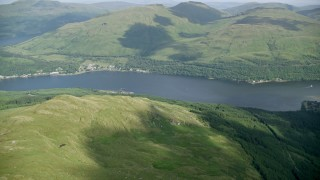 AX110_088 - 6K stock footage aerial video tilt from The Cobbler revealing Loch Long, Scottish Highlands, Scotland