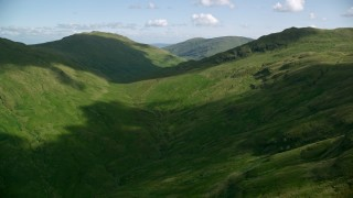 AX110_092 - 6K stock footage aerial video approach lush green mountain, Scottish Highlands, Scotland