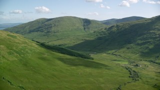 AX110_096 - 6K stock footage aerial video approach Beinn Dubh, a lush green mountain, Scottish Highlands, Scotland
