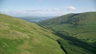 AX110_097 - 6K stock footage aerial video approach Beinn Dubh with Loch Lomond in the distance, Scottish Highlands, Scotland