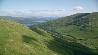AX110_098 - 6K stock footage aerial video approach Beinn Dubh with Loch Lomond in the background, Scottish Highlands, Scotland