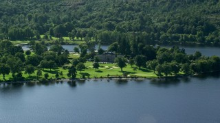 AX110_113 - 6K stock footage aerial video approach Rossdhu Mansion at Loch Lomond Golf Course, Luss, Scottish Highlands, Scotland