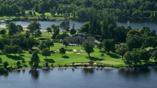 AX110_114 - 6K stock footage aerial video of an approach to Rossdhu Mansion at Loch Lomond Golf Course, Luss, Scottish Highlands, Scotland