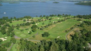 AX110_117 - 6K stock footage aerial video of an orbit of Loch Lomond Golf Course, Luss, Scottish Highlands, Scotland