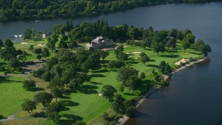 AX110_120 - 6K stock footage aerial video of Rossdhu Mansion at Loch Lomond Golf Course, Luss, Scottish Highlands, Scotland