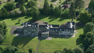AX110_126 - 6K stock footage aerial video of Lomond Castle by Loch Lomond, Arden, Scottish Highlands, Scotland