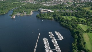 AX110_129 - 6K stock footage aerial video fly over a marina on Loch Lomond near aquarium, Alexandria, Scotland
