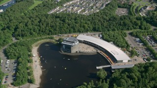 AX110_130 - 6K stock footage aerial video approach Loch Lomond Aquarium, Alexandria, Scotland