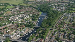 AX110_131 - 6K stock footage aerial video approach small bridges on River Leven through a small town, Alexandria, Scotland