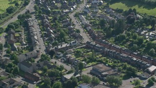 AX110_134 - 6K stock footage aerial video of homes and apartment buildings, Alexandria, Scotland