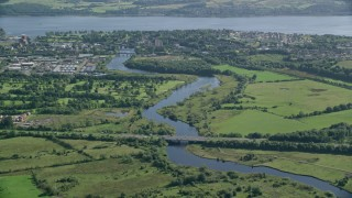 AX110_137 - 6K stock footage aerial video approach River Leven and waterfront town, Dumbarton, Scotland