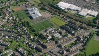 AX110_139 - 6K stock footage aerial video of a school and soccer field, Dumbarton, Scotland