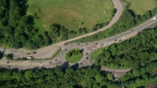 AX110_143 - 6K stock footage aerial video of a bird's eye view of a highway roundabout, Bowling, Scotland