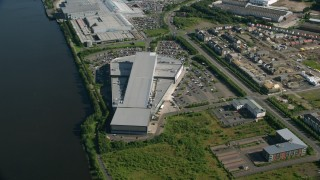 AX110_150 - 6K stock footage aerial video approach waterfront shopping center, Glasgow, Scotland