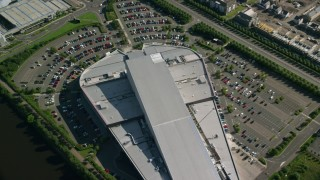 AX110_151 - 6K stock footage aerial video of orbiting riverfront shopping center in Glasgow, Scotland