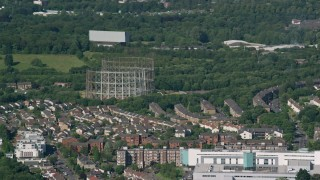 AX110_153 - 6K stock footage aerial video of residential neighborhood and metal structures, Glasgow, Scotland