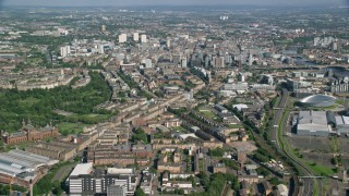 AX110_155 - 6K stock footage aerial video of approaching city buildings in Glasgow, Scotland