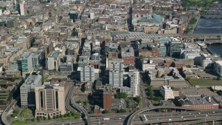 AX110_157 - 6K stock footage aerial video of approach city office buildings in Glasgow, Scotland