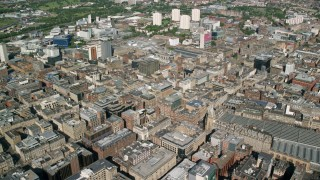 AX110_159 - 6K stock footage aerial video of passing city buildings, Glasgow, Scotland