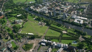 AX110_161 - 6K stock footage aerial video of monument and museum at Glasgow Green park by River Clyde, Scotland