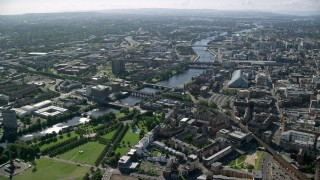 AX110_162 - 6K stock footage aerial video of River Clyde and bridges near city buildings, Glasgow, Scotland