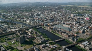 AX110_167 - 6K stock footage aerial video of River Clyde with bridges by city buildings, Glasgow, Scotland