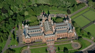 AX110_178 - 6K stock footage aerial video of bird's eye of Kelvingrove Art Gallery and Museum, Glasgow, Scotland
