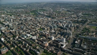 AX110_181 - 6K stock footage aerial video of a wide city view of Glasgow, Scotland