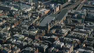 AX110_182 - 6K stock footage aerial video of Glasgow Central train station, Scotland