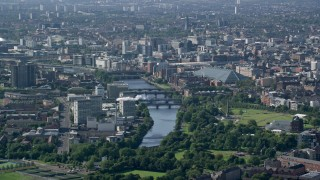AX110_190 - 6K stock footage aerial video of city view with the River Clyde, Glasgow, Scotland