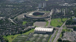 AX110_192 - 6K stock footage aerial video approach Hampden Park soccer stadium and by houses, Glasgow, Scotland